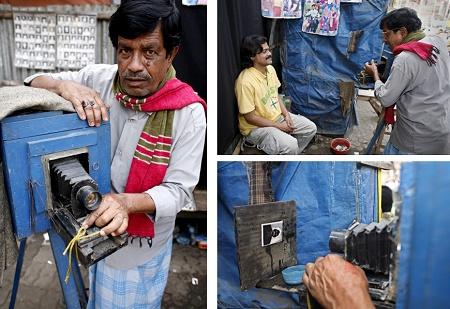 Safder Ali in mit seinem Fotografie-Geschäft in Dhaka, Bangladesh. Klick für Bildstrecke (Keystone / EPA / Abir Abdullah)