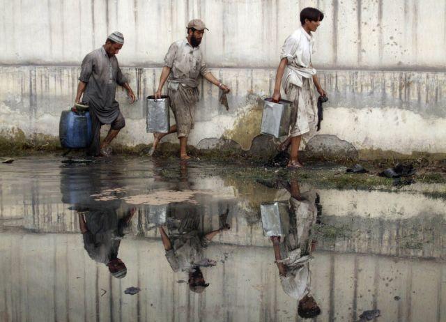 Ölräumer in Pakistan (Keystone)