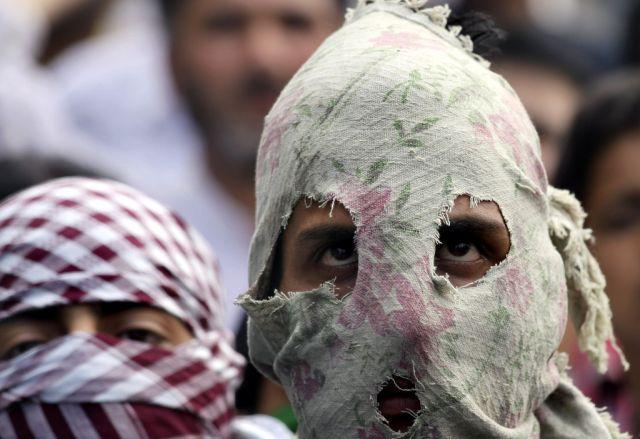 Maskierte Kashmiris (keystone)