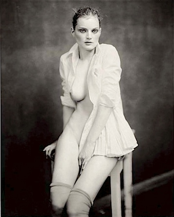 Paolo Roversi: Guinevere sitting on table, Paris, 2004