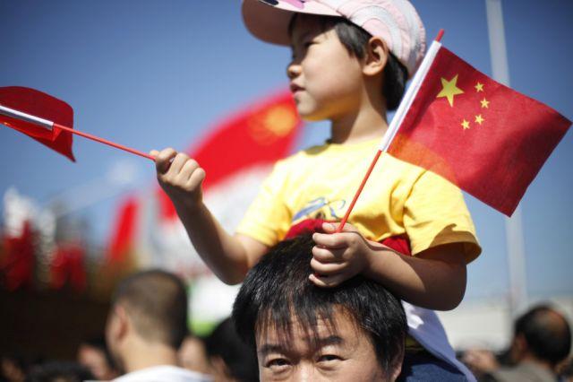 Vater und Sohn in China (keystone)