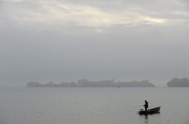 Fischer im Frauenchiemsee (keystone)