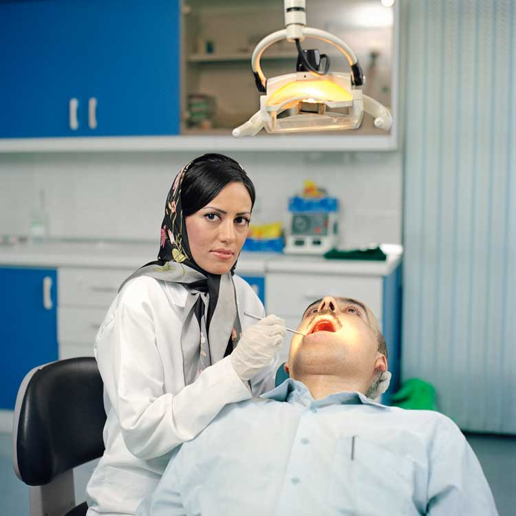 Paolo Woods: Sanaz, aged 32, is a dentist in the Jalaliyah district of Tehran. Iran, 2006