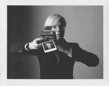 Oliviero Toscani: Andy Warhol with camera, 1974 © Oliviero Toscani.