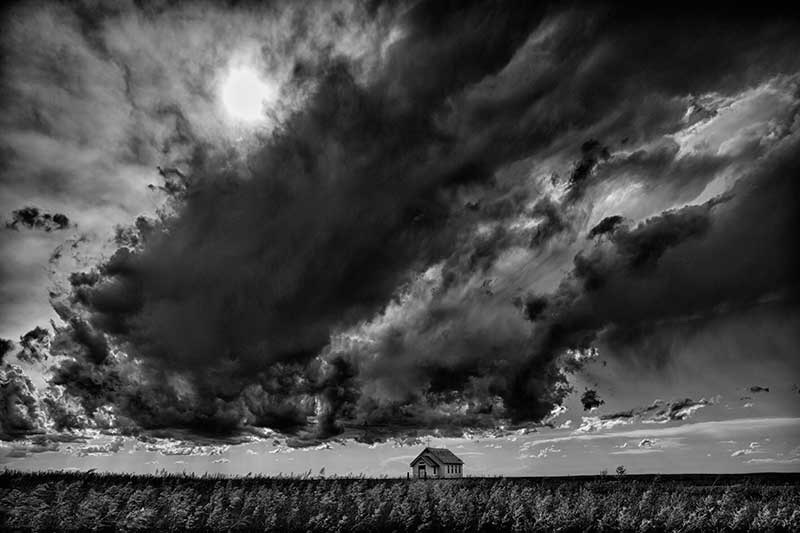 Heidi & Hans-Jürgen Koch: Storm clouds over church, South Dakota