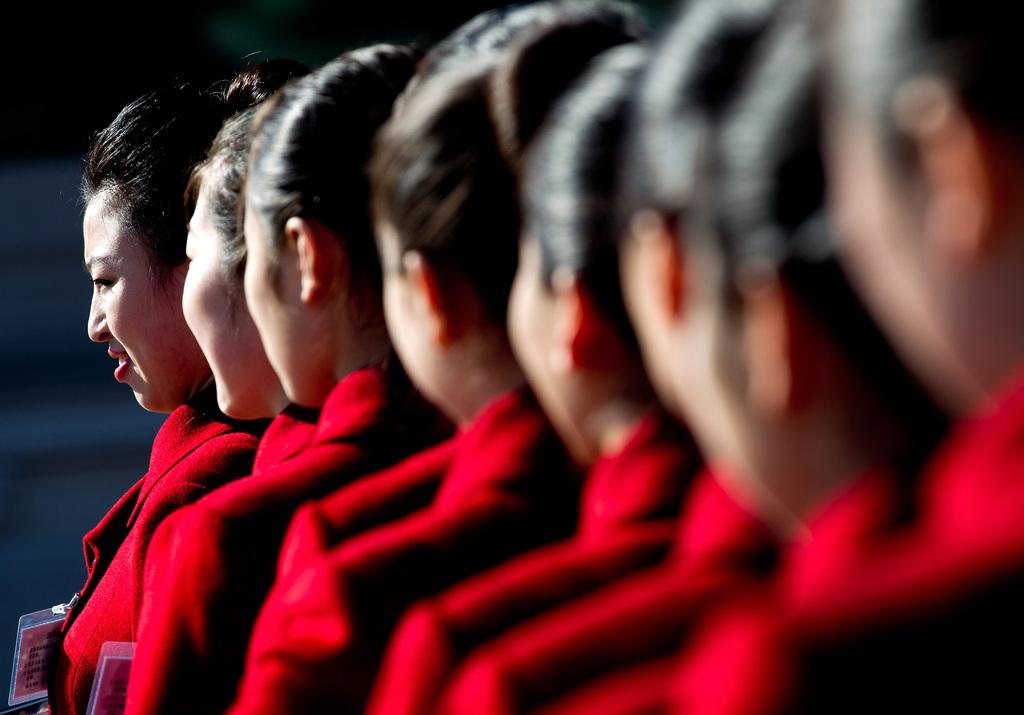 Hostessen am Tiananmen-Platz, Peking (AP Photo/Andy Wong)
