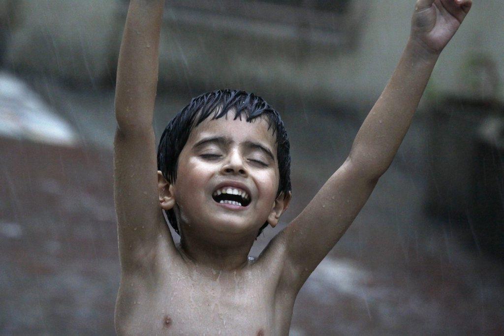 Freude über Regen, Amritsar, Indien EPA/RAMINDER PAL SINGH