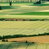 Landschaft mit Zug nshr Sehnde bei Hannover D EPA/Julian Stratenschulte