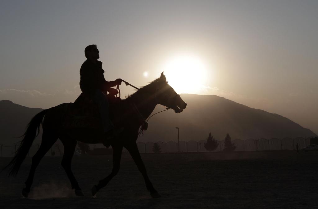 Reiter in den Bergen vor Kabul, Afghanistan (Keystone/AP Photo/Rahmat Gul)