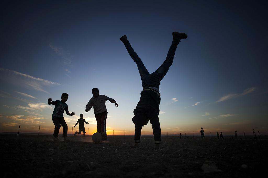 Spielende Kinder im Zaatari Flüchtlingscamp, Jordanien (Keystone/AP Photo/Manu Bravo)