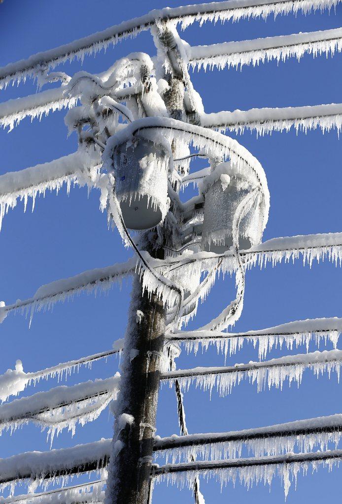 Eis auf den Stromleitungen in Dunwoody, USA (Keystone/EPA/Erik S. Leser)