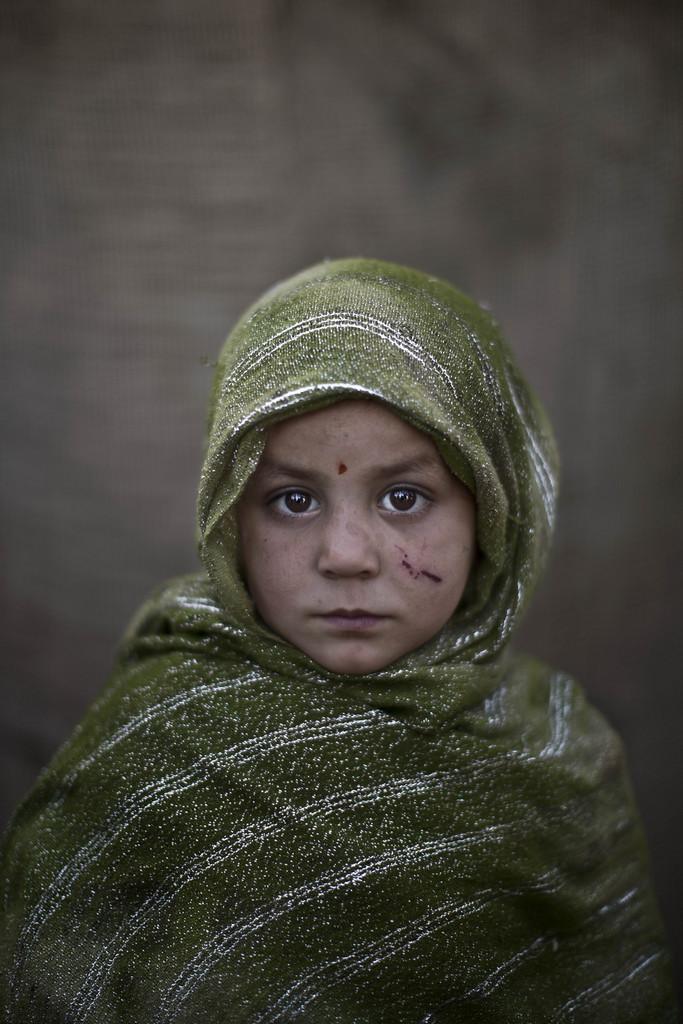 Serie - afghanische Flüchtlingskinder: Madina Juma'a, 4; Islamabad Pakistan (AP Photo/Muhammed Muheisen)