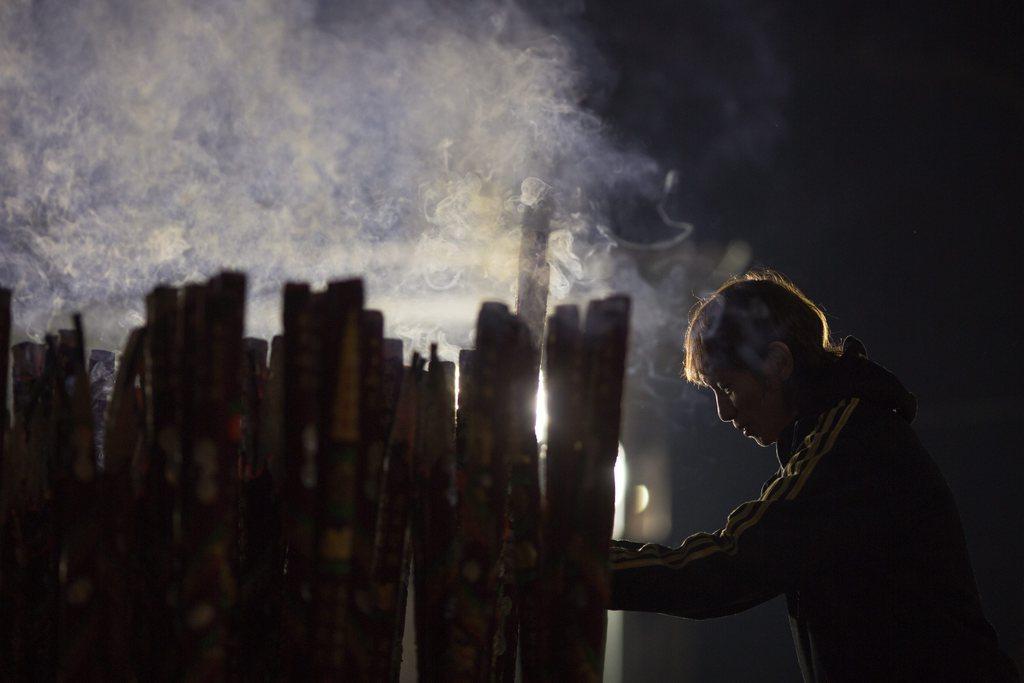 Gläubiger in Hong Kong, China (Keystone/EPA/Jerome Favre)