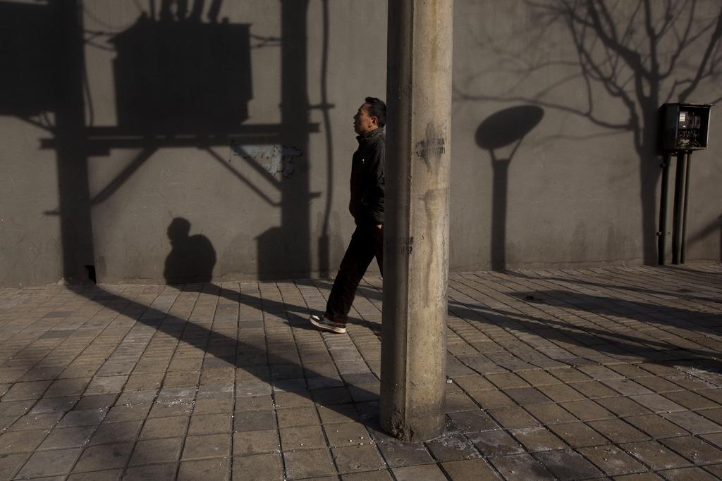 Straßenszene am späten Nachmittag, Beijing China (AP Photo/Ng Han Guan)