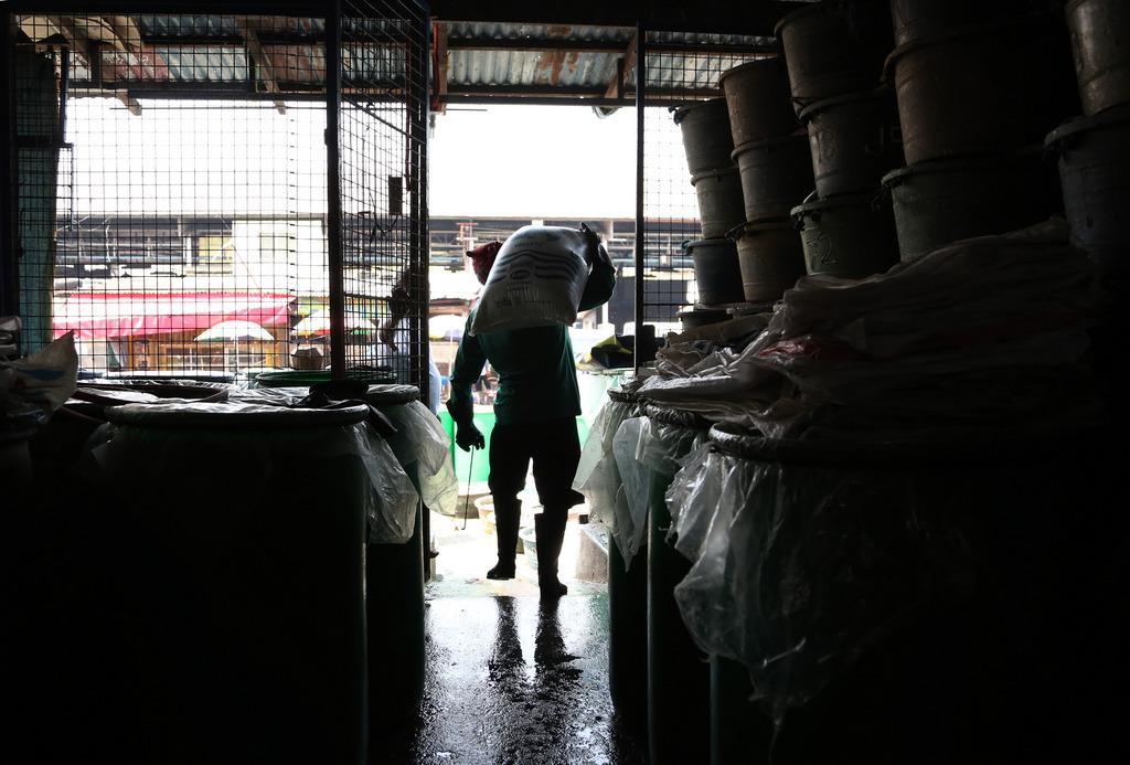 Arbeiter in Manila, Phillipinen (Keystone/AP Photo/Aaron Favila)