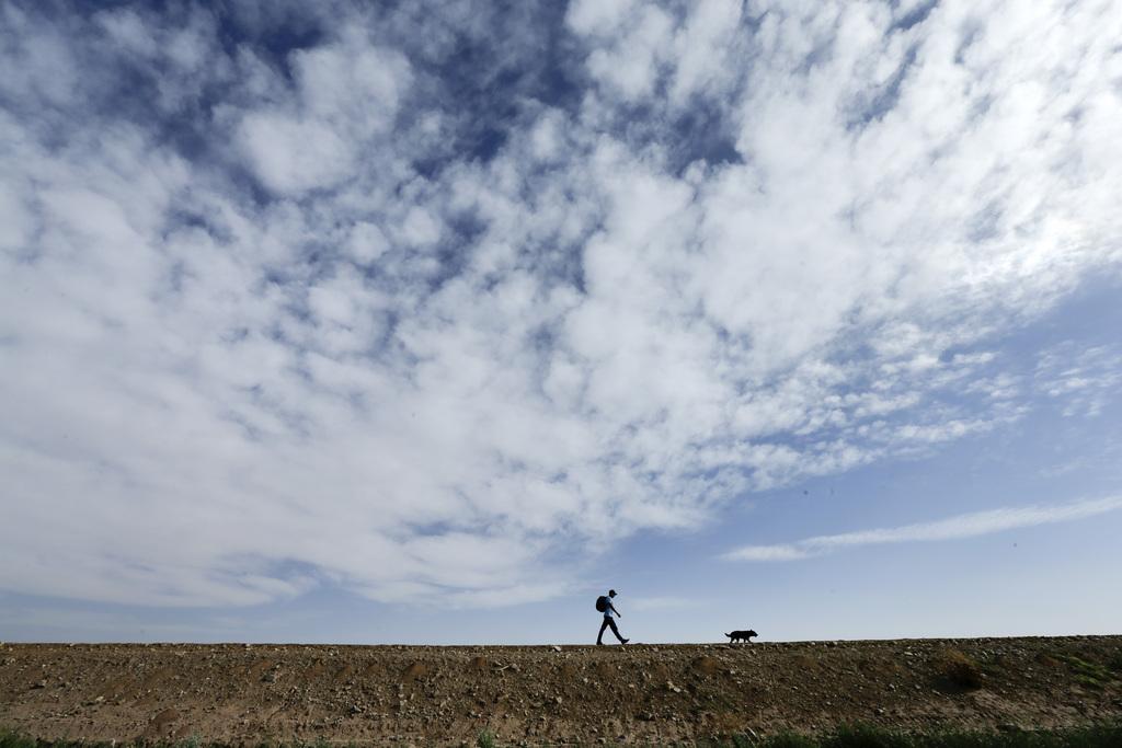 Spaziergang in Colonia Coahuila, Mexiko (Keystone/AP Photo/Gregory Bull)