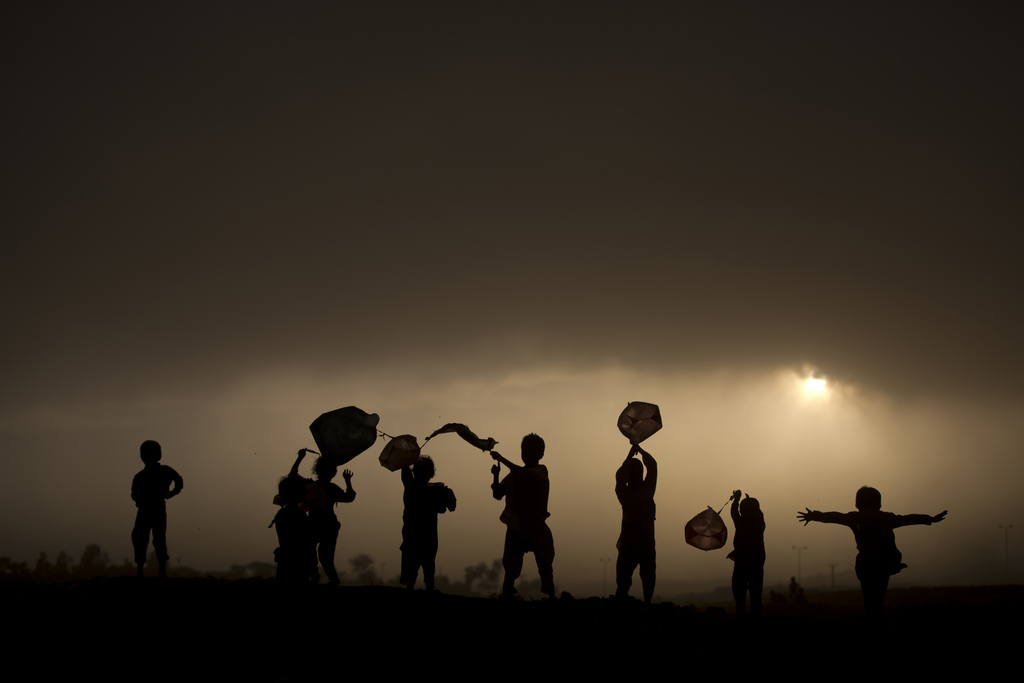 Spielende Kinder in Islamabad, Pakistan (Keystone/AP Photo/Muhammed Muheisen)