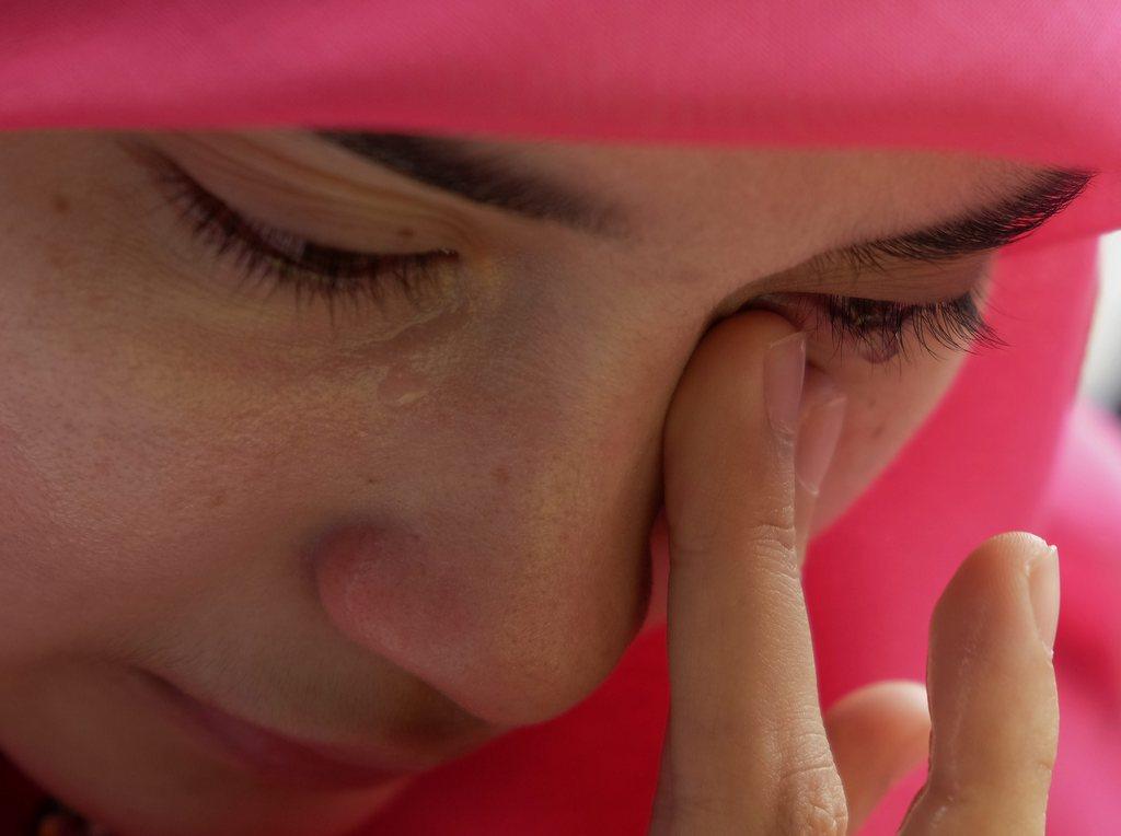 Tränen beim Gebet, nahe Kuala Lumpur, Malaysia, EPA/SHAMSHAHRIN SHAMSUDIN
