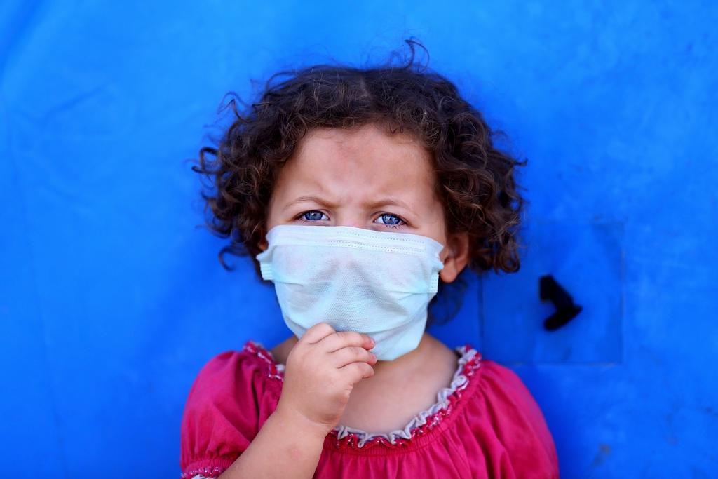 Mädchen mit Mundschutz, Irak (AP Photo)