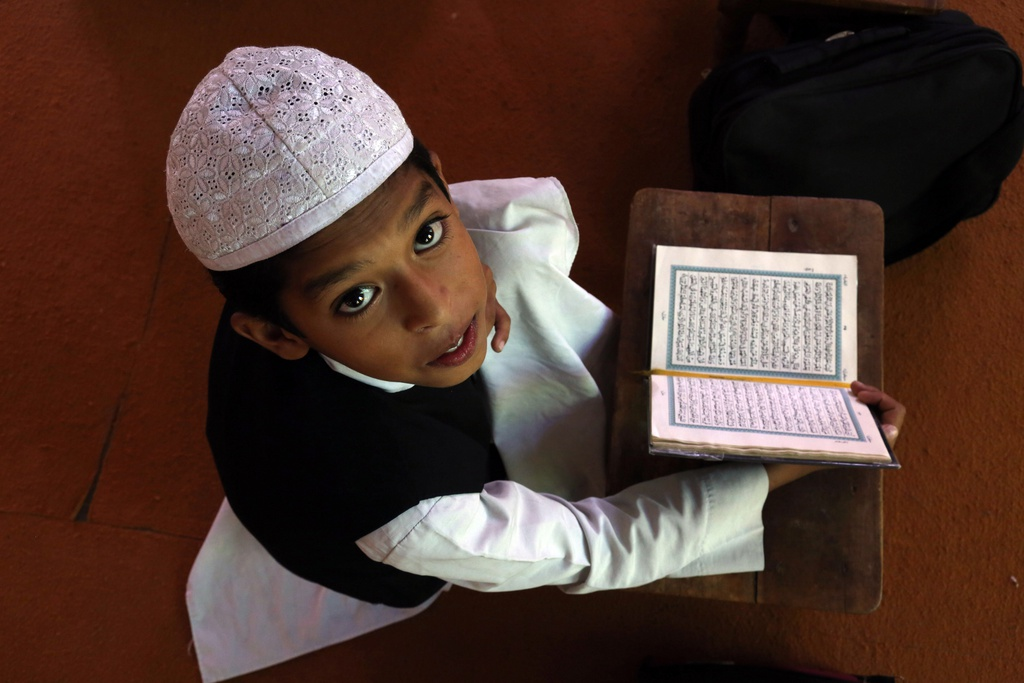 Koran-Studien in Hyderabad, Indien (Keystone/AP Photo/Mahesh Kumar A.)