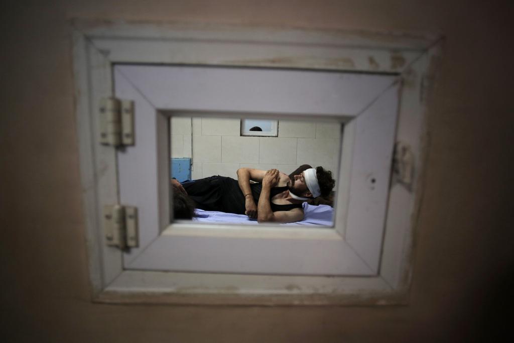 Palästinenser in einem Krankenhaus in Gaza City (Keystone/AP Photo/Khalil Hamra)
