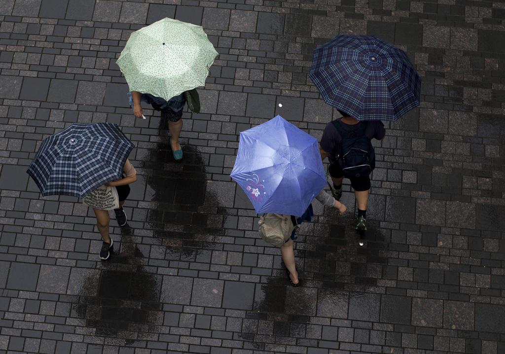 Regen in Beijing, China (Keystone/AP Photo/Andy Wong)