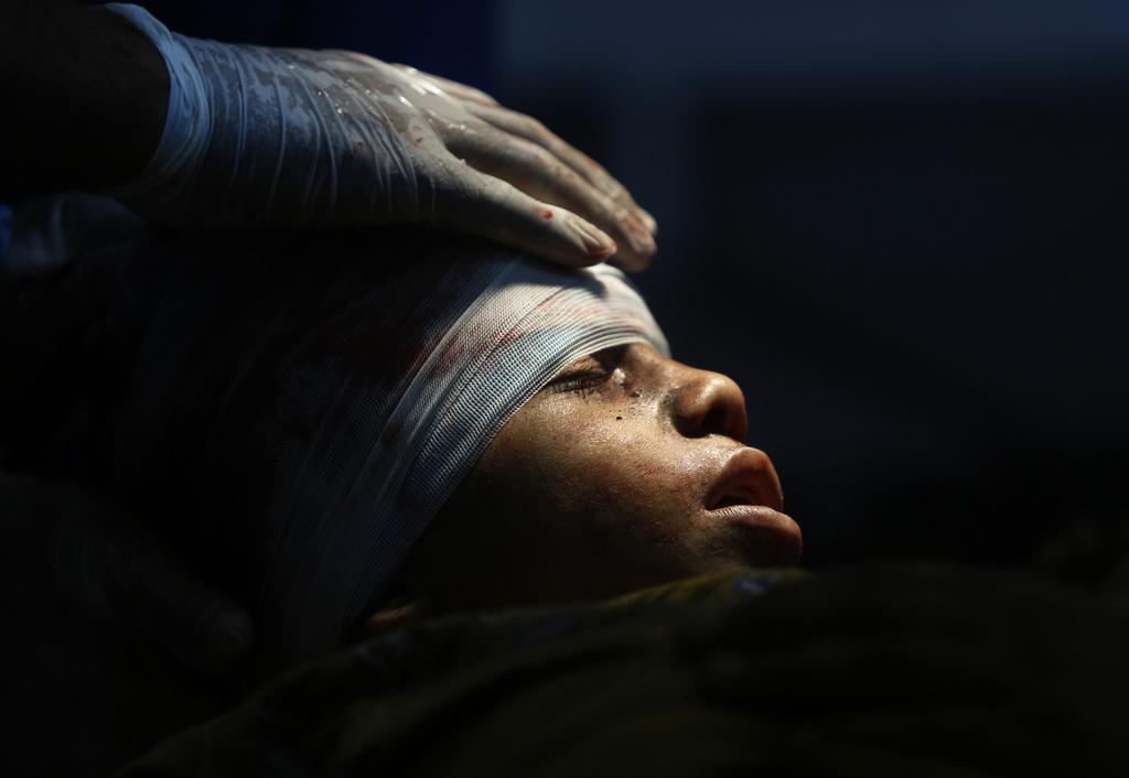Vorbereitung für ein Begräbnis in Gaza Stadt (Keystone/AP Photo/Hatem Moussa)