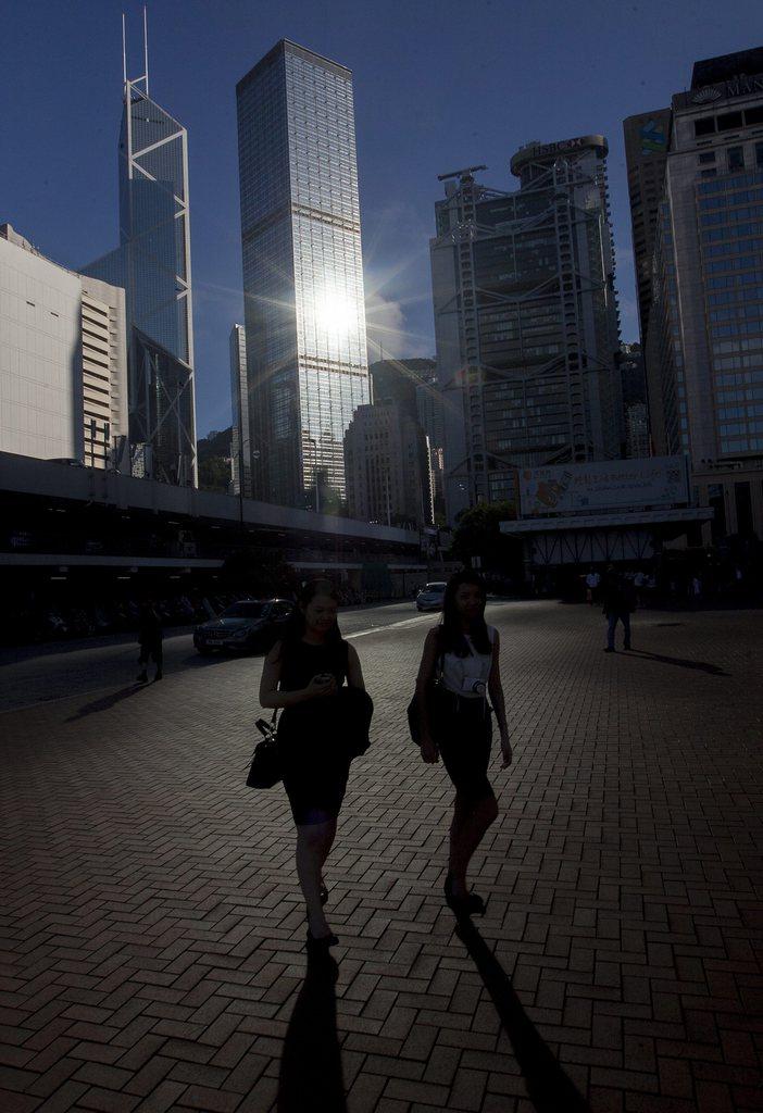 Die Sonne und die Skyline von Hong Kong (Keystone/EPA/Alex Hofford)