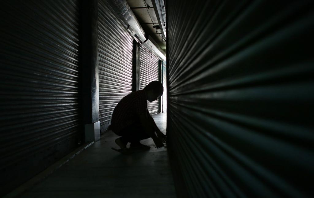 Ladenschluss in Gauhati, Indien (Keystone/AP Photo/Anupam Nath)