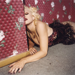 Madonna lying on the floor of a red room, September 1994, New York - © Bettina Rheims