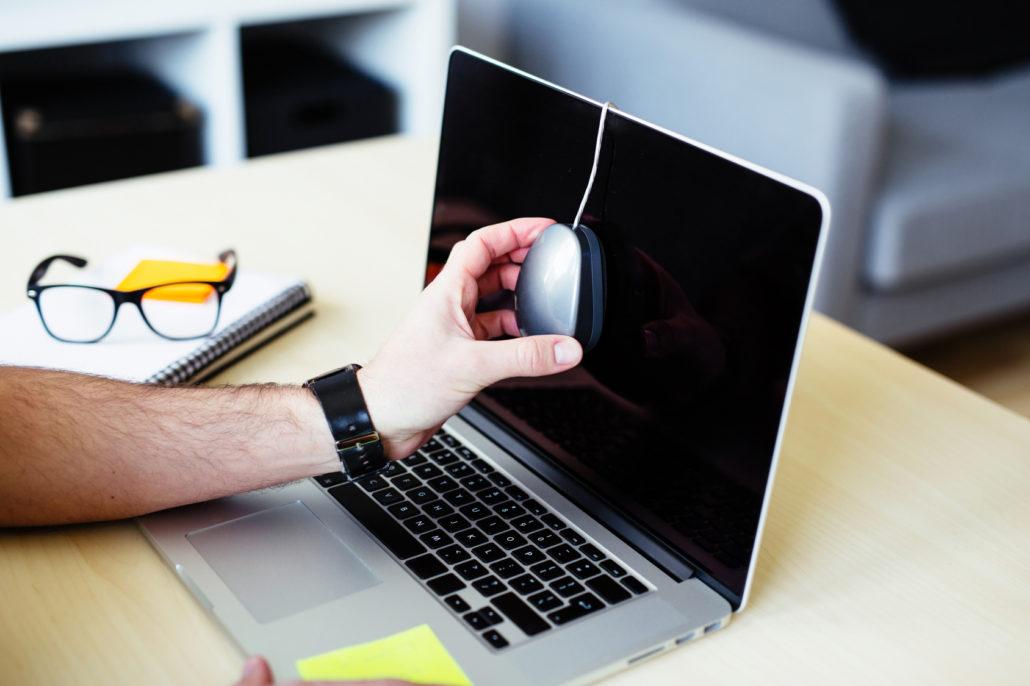 Man doing monitor calibration at home office
